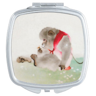 A Seated Monkey Observing An Insect Compact Mirror