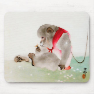 A Seated Monkey Observing An Insect Mouse Pad