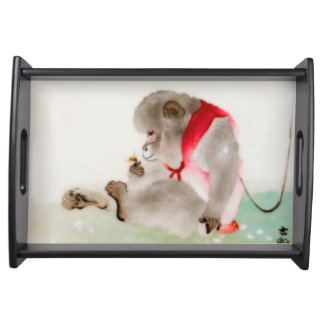 A Seated Monkey Observing An Insect Serving Tray