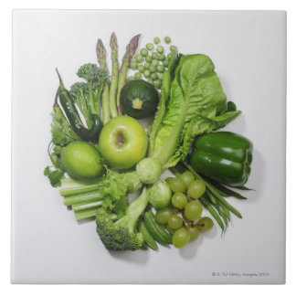 A selection of green fruits & vegetables. large square tile