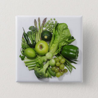 A selection of green fruits & vegetables. pinback button