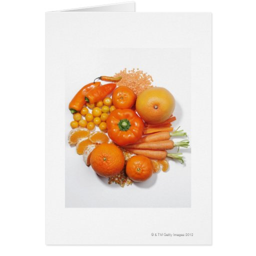 A selection of orange fruits & vegetables. greeting card