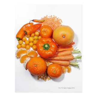 A selection of orange fruits & vegetables. postcard