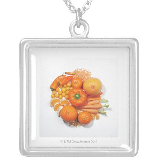 A selection of orange fruits & vegetables. silver plated necklace