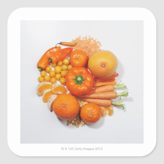 A selection of orange fruits & vegetables. square sticker