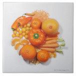 A selection of orange fruits & vegetables. ceramic tiles