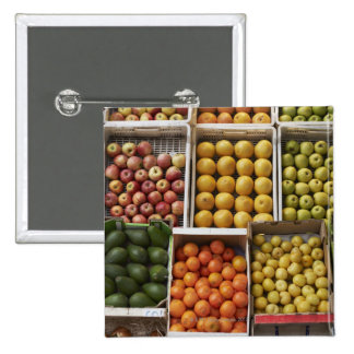 A selection of organic boxed fruit on pinback buttons