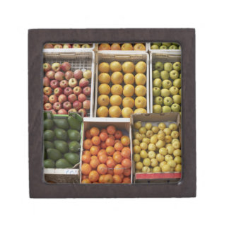A selection of organic boxed fruit on jewelry box