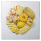 A selection of yellow fruits & vegetables. ceramic tile