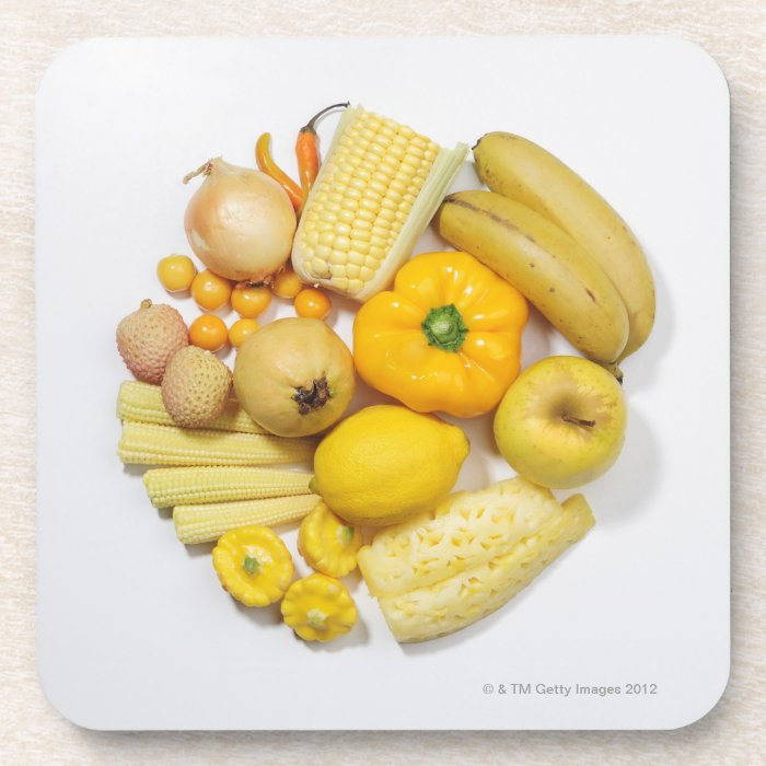 A selection of yellow fruits & vegetables. drink coaster
