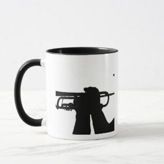 A service member plays a tune mug