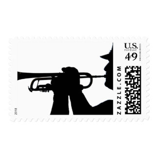 A service member plays a tune postage