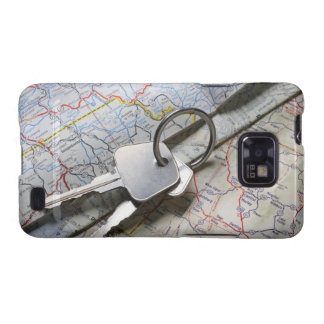 A set of car keys on a pile of road maps. samsung galaxy s2 covers