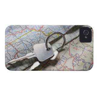 A set of car keys on a pile of road maps. iPhone 4 case