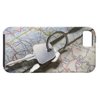 A set of car keys on a pile of road maps. iPhone SE/5/5s case