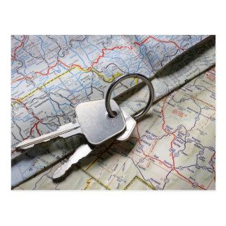 A set of car keys on a pile of road maps. postcard