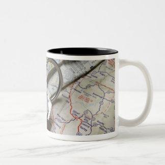 A set of car keys on a pile of road maps. Two-Tone coffee mug