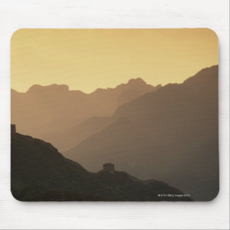 A setting sun filters through a sandstorm from mouse pad