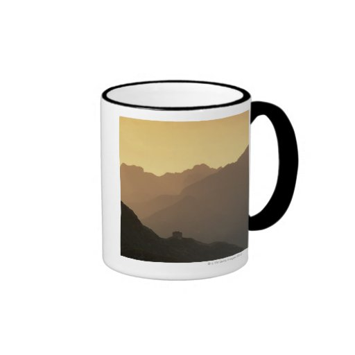 A setting sun filters through a sandstorm from ringer coffee mug
