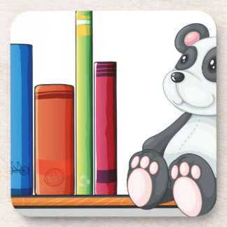 A shelf with books and a toy panda drink coasters