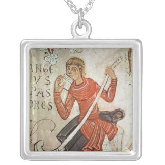 A shepherd playing a flageolet pendant