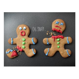 A shocked gingerbread man with broken leg postcard