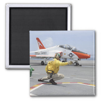 A shooter aboard the aircraft carrier refrigerator magnet