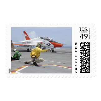 A shooter aboard the aircraft carrier postage stamp