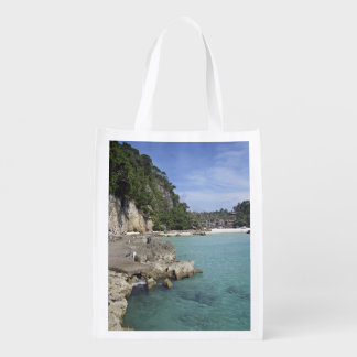 A Side View Of Paradise Beach Reusable Grocery Bags