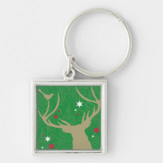 A silhouette of a deer with stars hanging from its keychain