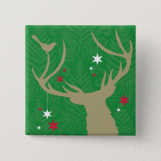 A silhouette of a deer with stars hanging from its pinback button