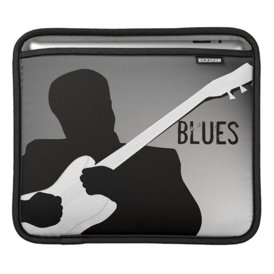 A silhouette of a guitar player, playing the blues sleeve for iPads