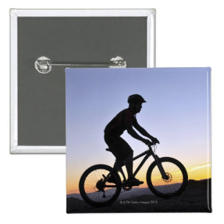 A silhouette of a mountain biker at sunset on 2 inch square button