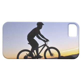 A silhouette of a mountain biker at sunset on iPhone SE/5/5s case