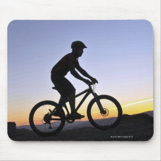 A silhouette of a mountain biker at sunset on mouse pad