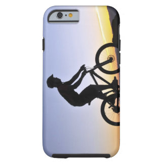 A silhouette of a mountain biker at sunset on tough iPhone 6 case