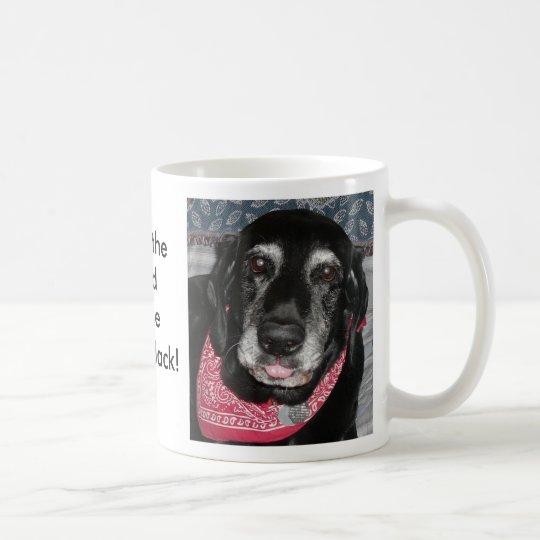 A silly mug of a silly dog's mug.