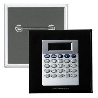 A silver calculator button