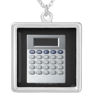 A silver calculator square pendant necklace