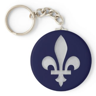Silver Fleur-de-lys Keychain on a background of blue that you can change