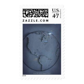 A simple blue global map of the earth showing postage stamp