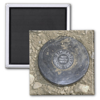 A simulated land mine 2 inch square magnet