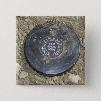 A simulated land mine button