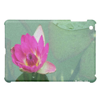 A single pink waterlily in a pond iPad mini cases