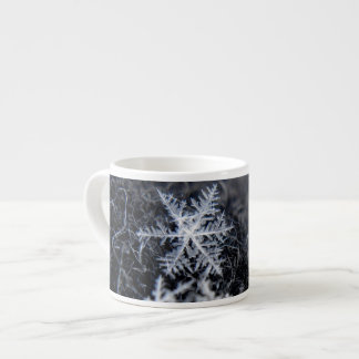 A single snowflake on stands out espresso cup