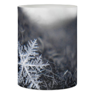 A single snowflake on stands out flameless candle