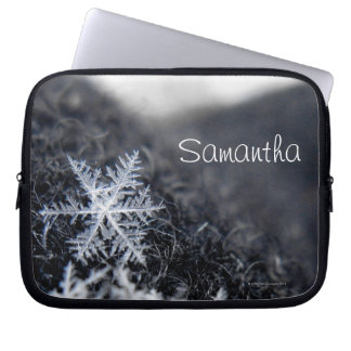 A single snowflake on stands out laptop sleeve