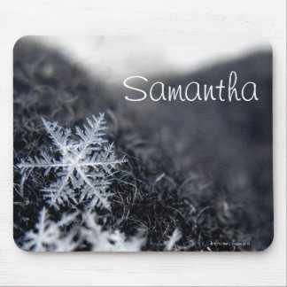 A single snowflake on stands out mouse pad