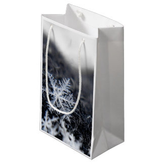 A single snowflake on stands out small gift bag