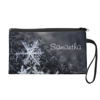 A single snowflake on stands out wristlet purse